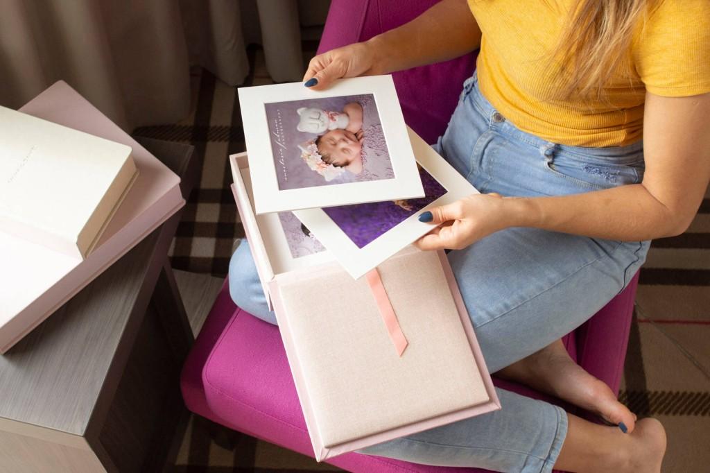 browsing through baby pink foliobox matted prints