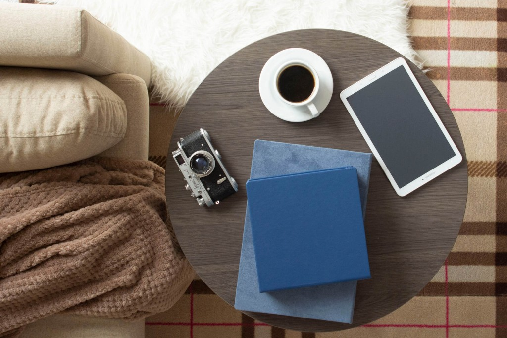 eco leather folio box on a coffee table with classic camera and a modern tablet